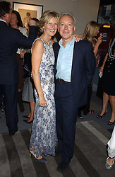 LINDKA CIERACH and actor NIKOLAS GRACE at a private view of fashion designer Lindka Cierach's Couture Dresses drawn by Trudy Good held at the Belgravia Gallery, 45 Albemarle Street, London on 21st September 2005.<br />