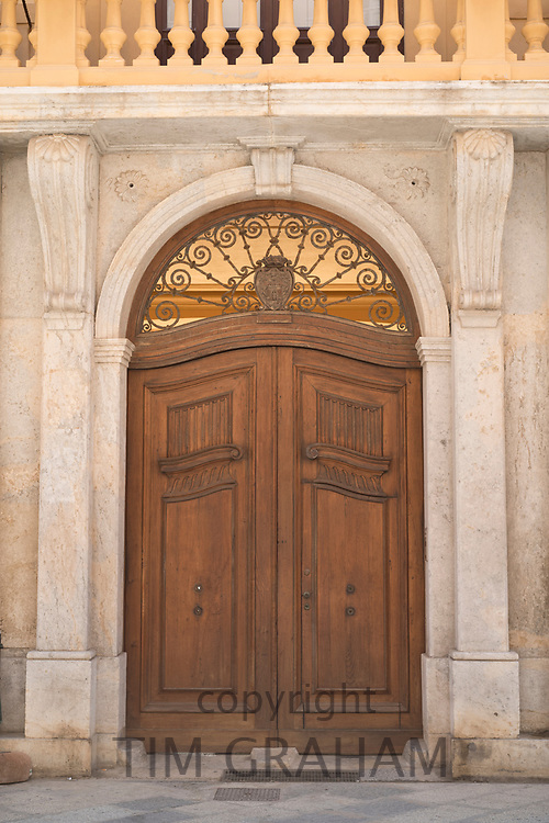 Quaint old weather-beaten wooden double door and doorway in historic centre of Trapani, Sicily, Italy