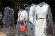 As the UKs Coronavirus death toll during the governments social distancing lockdown, rose by 384 to 33,998, and the R rate of infection is reported to be between 0.7 and 1.0, clothing mannequins in the window of a closed branch of Ted Baker, are covered in polythene plastic, in a deserted City of London, the capitals financial district, on 15th May 2020, in London, England.