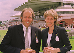 LORD BRUCE DUNDAS and MISS SANTA PALMER-TOMKINSON a family friend of HRH The Prince of Wales who will attending her wedding to Simon Sebag-Montefiore later this year, at a race meeting in Sussex on 31st July 1998.<br /> MJH 4