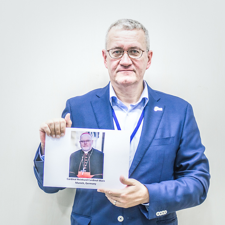 2018<br /> Mathias Katsch, a survivor and an activist from Germany, poses for a portrait showing a picture of Reinhard Cardinal Marx now archbishop of Munich who as bishop of Trier mishandled cases of child sexual abuses by one of his priests and violated the guidelines of the German bishop conference. © Simone Padovani