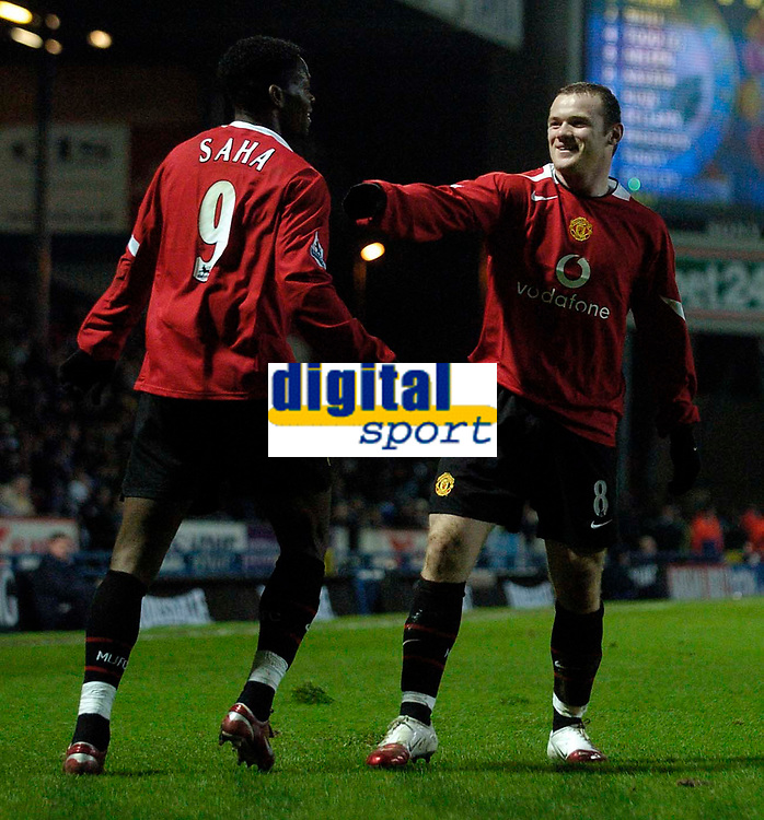 Photo: Jed Wee.<br /> Blackburn Rovers v Manchester United. Carling Cup. Semi Final, 1st Leg. 11/01/2006.<br /> <br /> Manchester United's Wayne Rooney (R) celebrates with Louis Saha.