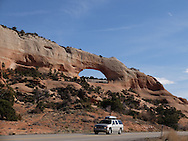 Moab - 14 March 2016 - A motorist drives past one of the estimated 2000 natural sandstone arches in the Arches National Park in the American state of Utah. Picture: Ryan Eyer/Allied Picture Press/APP