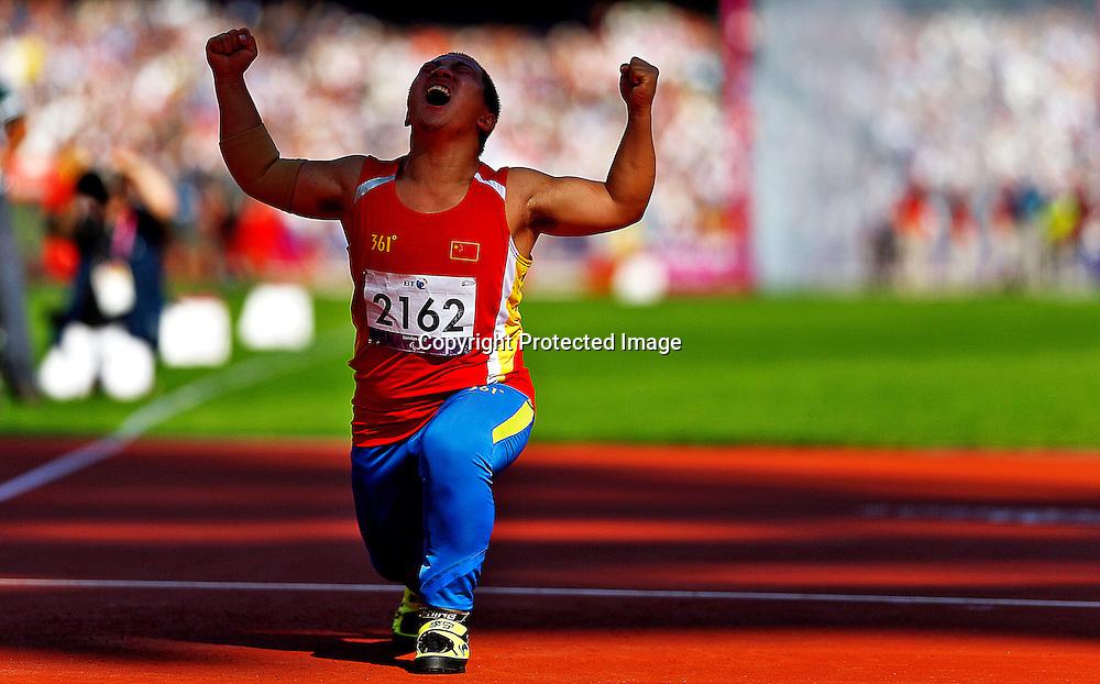 Zhiming Wang of China celebrates after winning gold medal in Men's Javelin Throw F40 final at Olympic Stadium during the London 2012 Paralympic Games, London, Britain, 07 September 2012.  EPA/KERIM OKTEN