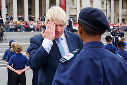 © Licensed to London News Pictures. 03/08/2015. London, UK. Mayor of London, Boris Johnson saluting a volunteer police cadet whilst attending a parade for the capital's young police volunteers with Metropolitan Police Commissioner Bernard Hogan-Howe in Trafalgar Square, London on Monday, August 3, 2015. Photo credit: Tolga Akmen/LNP