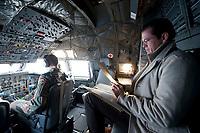 30 NOV 2010, JAGEL/GERMANY:<br /> Karl-Theodor zu Guttenberg, CSU, Bundesverteidigungsminister, liest im Cockpit in seinen Unterlagen, waehrend dem Flug mit einer Transall vom Fliegerhorst Jagel nach Berlin, nach der  Rueckkehr der in Afghanistan eingesetzten RECCE TORNADO Aufklaerungsjets<br /> IMAGE: 20101130-01-064<br /> KEYWORDS: Bundeswehr, Armee, Luftwaffe, lesen