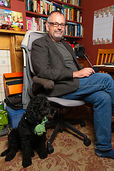 Author Ian W Sainsbury who is up for the Kindle Storyteller Award with his novel The Picture On The Fridge, at his home in Beccles, Suffolk. London, September 17 2019.
