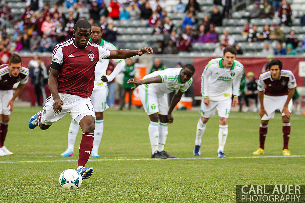 March 30th, 2013 Commerce City, CO - After a penalty in the goal box, Colorado Rapids midfielder Hendry Thomas (12) scores on a penalty kick in the second half of the MLS match between the Portland Timbers and the Colorado Rapids at Dick's Sporting Goods Park in Commerce City, CO