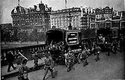 Railway Strike, Britain, 1911.  Soldiers escorting Pickfords horse-drawn vans used in the strike as they cross Waterloo Bridge, London.