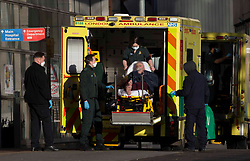 © Licensed to London News Pictures.21/01/2021, London,UK. A patient is transferred on stretcher from an ambulance at the Royal London Hospital in east London as the third national lockdown continues and hospitals are struggling to cope with the number of admissions. Photo credit: Marcin Nowak/LNP