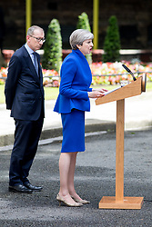 © Licensed to London News Pictures. 09/06/2017. London, UK. British Prime Minister Theresa May makes a statement in Downing Street, next to her husband Philip May. Parliament is currently hung, with no party gaining an overall majority. Photo credit : Tom Nicholson/LNP