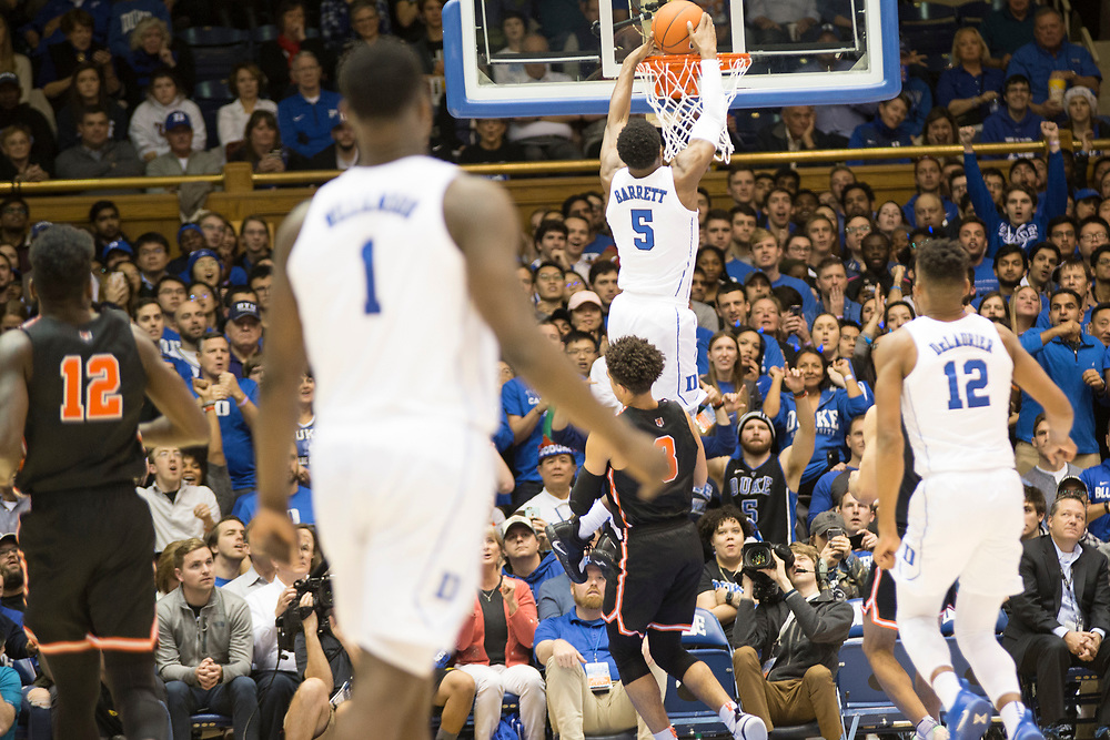RJ Barrett slams it down as Zion Williamson watches during the Duke Blue Devil's home game against the Princeton Tigers on December 18, 2018.