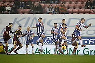 Ipswich's Tom Lawrence (27) shoots through the Wigan wall during the EFL Sky Bet Championship match between Wigan Athletic and Ipswich Town at the DW Stadium, Wigan, England on 17 December 2016. Photo by Craig Galloway.