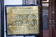 Brass sign for historic Hen and Chickens pub, Abergavenny, Monmouthshire, South Wales, UK