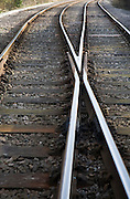 Two railway lines crossing at points near Woodbridge, Suffolk, England