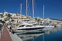 Puerto Banus, Marbella, Spain, marina, yachts, mountains, palms, palm trees, beach, blue sky, white clouds, sea shore, 201211100892..Copyright Image from Victor Patterson, 54 Dorchester Park, Belfast, UK, BT9 6RJ..Tel: +44 28 9066 1296.Mob: +44 7802 353836.Voicemail +44 20 8816 7153.Skype: victorpattersonbelfast.Email: victorpatterson@me.com.Email: victorpatterson@ireland.com (back-up)..IMPORTANT: If you wish to use this image or any other of my images please go to www.victorpatterson.com and click on the Terms & Conditions. Then contact me by email or phone with the reference number(s) of the image(s) concerned.