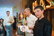 Bayne Albin celebrates his Bar Mitzvah with friends and family during his reception at Temple Beth Abraham in Oakland, California, on May 3, 2014. (Stan Olszewski/SOSKIphoto)