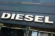Sign for the high street clothing brand Diesel in Birmingham, United Kingdom.