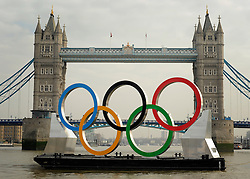 © Licensed to London News Pictures. 28/02/2012, London, UK. The rings in front of Tower Bridge. Giant Olympic rings measuring 11 metres high by 25 metres wide are floated down the River Thames on a barge, marking 150 days to go to the start of the London 2012 Olympic and Paralympic Games. Photo credit : Stephen Simpson/LNP