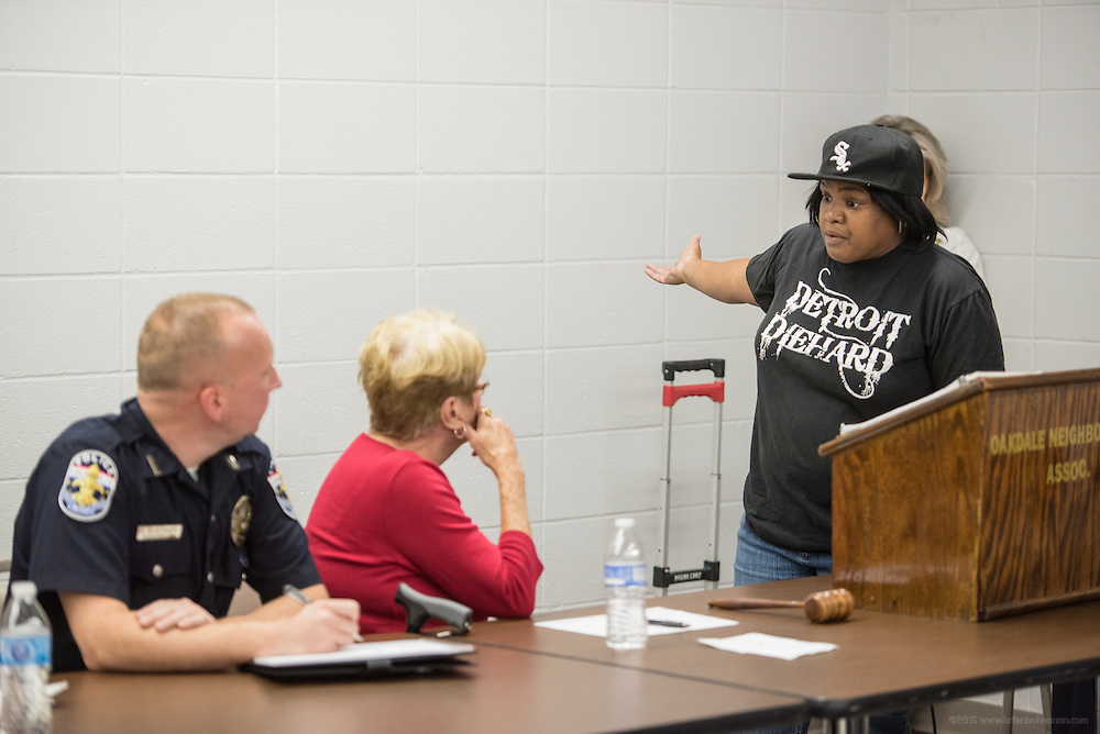 Ranada Woods tells how she suspects that local kids looted her home after a fire at the Oct. 26, 2015 Oakdale neighborhood meeting at the Salvation Army on Beecher Street in Louisville, Ky. (Photo by Brian Bohannon)