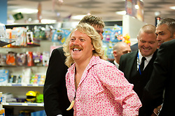 """Leigh Francis in character as TV JUICE host Keith Lemon leaves WHSmith in Meadowhall shopping centre in Sheffield after hi successful signing event for . 'Keith Lemon: The Rules""""  The event originally scheduled for 5:00 - 5:30 was so popular that Keith started signing early and didn't finish until 7:05pm despite sales of the book being restricted.  .1st November 2011. Image © Paul David Drabble"""