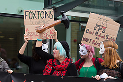 © Licensed to London News Pictures. 09/10/2016. LONDON, UK.  Jane Nicholl and members of Class War, Women's Death Brigade stage a protest outside Foxtons estate agent in Islington on 8th October 2016. The women only protest was a reaction to the alleged assault of Class War member, Jane Nicholl by a Foxtons employee during a protest outside Boris Johnson's house in July following which, three Foxton's employees were sacked after fighting with protesters and police. It has been reported that the Crown Prosecution Service (CPS) have recently dropped the assault charges against a Foxton's employee to Nicholl's due to a lack of evidence.  Photo credit: Vickie Flores/LNP