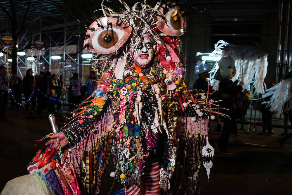 New York, NY - 31 October 2016. A man wears an elaborate costume covered in hundreds of beads, doll parts, and other objects in the Greenwich Village Halloween Parade.