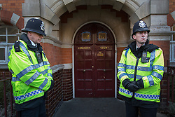 © licensed to London News Pictures. London, UK 13/12/2012. Police guard the entrance to Westminster Coroner's Court. The inquest into the death of Jacintha Saldanha, the nurse who apparently took her own life after being duped by two Australian DJ hoax callers, has been opened at Westminster Coroner's Court on 13/12/12 in London. Photo credit: Tolga Akmen/LNP