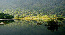 File photo dated 05/09/13 of early autumn reflections in Crummock Water in the Lake District in Cumbria, as the Lake District has been designated as a World Heritage Site, Unesco has said.