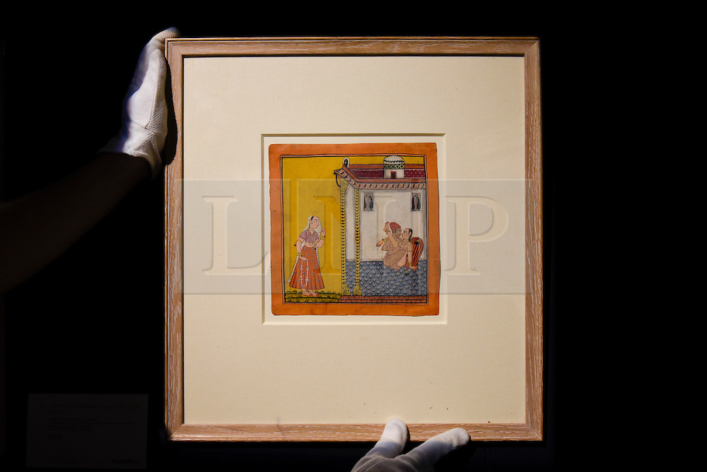 "© Licensed to London News Pictures. 10/02/2017. London, UK.  A technician hangs ""A Loving Couple Watched By A Maiden"", North India, 1700-40, (est.3-4k), at the preview of the ""Erotic: Passion & Desire"" sale at Sotheby's in New Bond Street.  The sale, which will take place on 16 February, encompasses representations of love and sex from antiquity to the present day.  Photo credit : Stephen Chung/LNP"