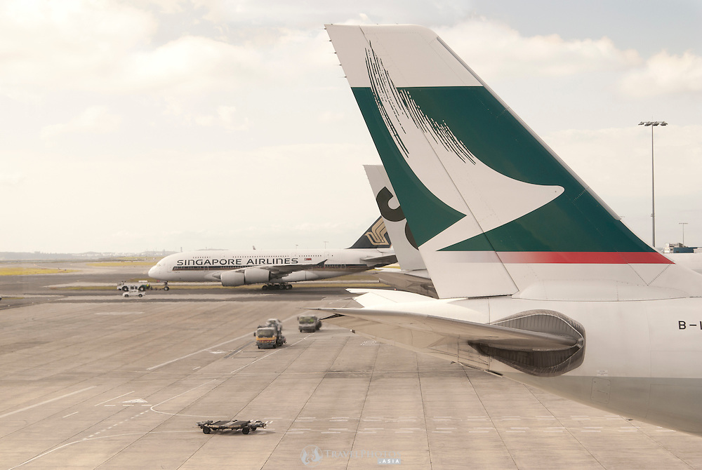 A Cathay Pacific  and Singapore Airlines aircraft at Sydneys Charles Kingford Smith International Airport.