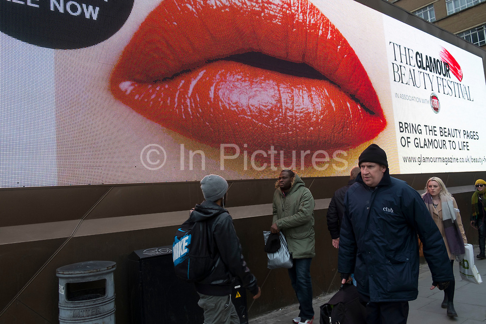A large scale pair of red lips on an electronic billboard announces the Glamour Beauty Festival in London, England, United Kingdom. (photo by Mike Kemp/In Pictures via Getty Images)