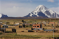 A view of Mariscal Sucre, a neighborhood in El Alto.   Many of the adobe homes in Mariscal Sucre have no running water and families are forced to collect rain water, use dirty wells or go to a nearby home with water.   The private water company, Aguas de Illimani, had their contract annulled by the Bolivian government after members of the politically powerful El Alto community took to the streets to protest poor service and high installation fees.