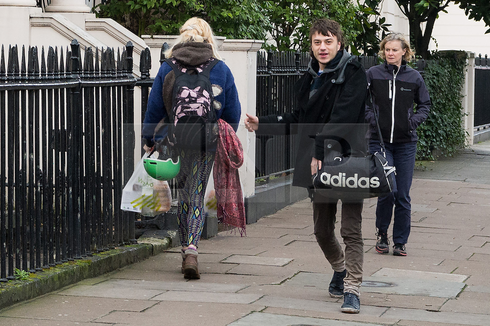 © Licensed to London News Pictures. 30/01/2017. A man leaves and woman enters a £15m London mansion owned by Russian billionaire Andrey Goncharenko. Members of the Autonomous Nation of Anarchist Libertarians (Anal) have taken over The grade II listed building in Eaton Square was built in the early 1820's and was is believed to have been empty since Russian oligarch Andrey Goncharenko bought it in 2014.  The group intend to use the property as a homeless shelter and a community centre.  London, UK. Photo credit: Ray Tang/LNP
