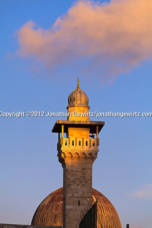 A minaret stands in front of the dome of the Al Aqsa mosque on the Temple Mount in Jerusalem. WATERMARKS WILL NOT APPEAR ON PRINTS OR LICENSED IMAGES.