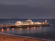 Editions of 8<br /> Dusk lighting creates moody ambience on the North Side of the Bournemouth Pier in the United Kingdom