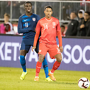 EAST HARTFORD, CONNECTICUT- October 16th:  Andy Polo #14 of Peru defended by Tim Weah #11 of the United States during the United States Vs Peru International Friendly soccer match at Pratt & Whitney Stadium, Rentschler Field on October 16th 2018 in East Hartford, Connecticut. (Photo by Tim Clayton/Corbis via Getty Images)