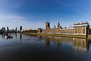 April 7, 2020, London, England, United Kingdom: The Palace of Westminster is reflected in the river Thames opposite St Thomas' Hospital in central London as British Prime Minister Boris Johnson was moved to intensive care after his coronavirus symptoms worsened in London, Tuesday, April 7, 2020. Johnson was admitted to St Thomas' hospital in central London on Sunday after his coronavirus symptoms persisted for 10 days. Having been in hospital for tests and observation, his doctors advised that he be admitted to intensive care on Monday evening. The new coronavirus causes mild or moderate symptoms for most people, but for some, especially older adults and people with existing health problems, it can cause more severe illness or death. (Credit Image: © Vedat Xhymshiti/ZUMA Wire)