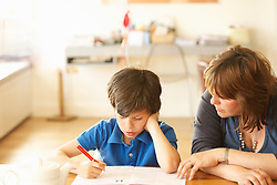 Mother and Son Doing Homework at Kitchen Table