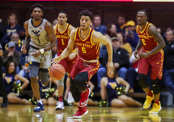 Mar 6, 2019; Morgantown, WV, USA; Iowa State Cyclones guard Lindell Wigginton (5) steals the ball during the first half against the West Virginia Mountaineers at WVU Coliseum. Mandatory Credit: Ben Queen-USA TODAY Sports