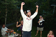PRICE CHAMBERS / NEWS&GUIDE<br /> Surrounded by friends in his backyard, Jim Stanford reacts as he hears the news that he has won the primary election for a seat on the Jackson Town Council on Tuesday night.