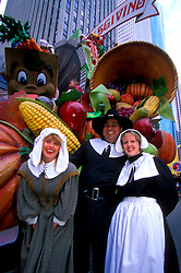 Stock photo of participants dressed as pilgrims in the Thanksgiving Day parade making its way through downtown Houston Texas