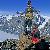 BAFFIN ISLAND, Nunavut, Canada. Jared Ogden & Greg Child on summit of Great Sail Peak, after month-long big wall climb above Stewart Valley. (MR)