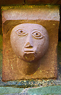 Norman Romanesque exterior corbel no 54 - sculpture of a male stylised simple round head. The Norman Romanesque Church of St Mary and St David, Kilpeck Herefordshire, England. Built around 1140 .<br /> <br /> Visit our MEDIEVAL PHOTO COLLECTIONS for more   photos  to download or buy as prints https://funkystock.photoshelter.com/gallery-collection/Medieval-Middle-Ages-Historic-Places-Arcaeological-Sites-Pictures-Images-of/C0000B5ZA54_WD0s