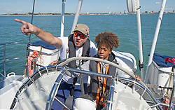 Simon Le Bon, with 14 year old Eddie Pereira, on a 72 foot Challenger yacht in the Solent off Portsmouth where he announced his partnership with the Tall Ships Youth Trust .