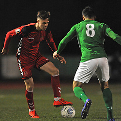 TELFORD COPYRIGHT MIKE SHERIDAN 26/3/2019 - Ryan Barnett of AFC Telford (on loan from Shrewsbury Town Football Club) takes on Conor Branson during the Vanarama National League North fixture between Bradford Park Avenue and AFC Telford United at Horsfall Stadium.
