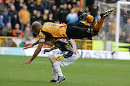 Coca Cola championship, Wolverhampton Wanderers v Cardiff City on Sunday 22nd Feb 2009 . pic by Andrew Orchard, Andrew Orchard sports photography, Karl Henry of Wolves takes a tumble over Cardiff's Chris Burke.