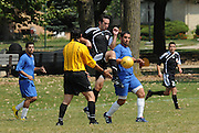 Eduardo Jimenez (#11) of Deportivo Colomex takes the offensive with a high kick against Team Shlama F.C. during National Soccer League play in Skokie, Il.