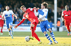 Peterborough United's Luke James battles with Leyton Orient's Gary Sawyer - Photo mandatory by-line: Joe Dent/JMP - Mobile: 07966 386802 - 07/03/2015 - SPORT - Football - Peterborough - ABAX Stadium - Peterborough United v Leyton Orient - Sky Bet League One