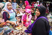 09 JULY 2013 - PATTANI, PATTANI, THAILAND: Muslim women chat in the market in Pattani.  Pattani, along with Narathiwat and Yala, are the only three Muslim majority provinces in Thailand.     PHOTO BY JACK KURTZ